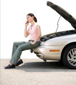 Woman with Car Trouble on Her Cell Phone
